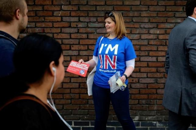 A woman hands out leaflets campaigning to stay in Europe for the BREXIT vote in London, Britain, May 20, 2016. REUTERS/Kevin Coombs