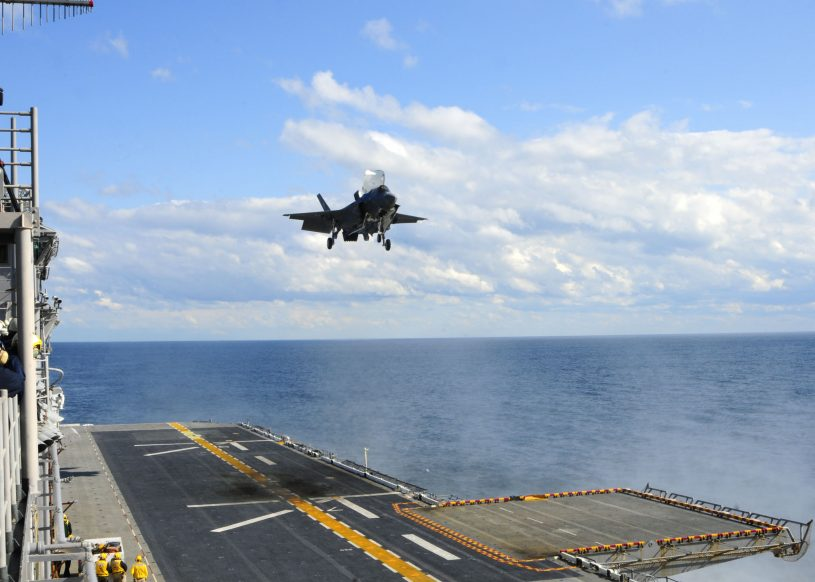 111003-N-ZZ999-002 ATLANTIC OCEAN (Oct. 3, 2011) An F-35B Lightning II makes the first vertical landing on a flight deck at sea aboard the amphibious assault ship USS Wasp (LHD 1). The F-35B is the Marine Corps Joint Strike Force variant of the Joint Strike Fighter and is designed for short takeoff and vertical landing on Navy amphibious ships. (U.S. Navy photo by Mass Communication Seaman Natasha R. Chalk/Released)
